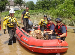 SDF's New York teams board a swift water boat to search for stranded flood survivors in the areas most affected by June storms